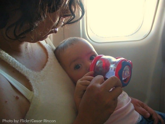 baby eating on plane