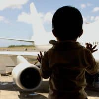 baby waiting for plane