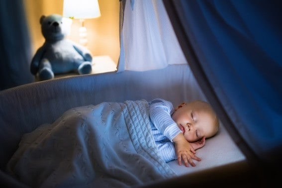 Consistent night sleep will help your child get over jet lag