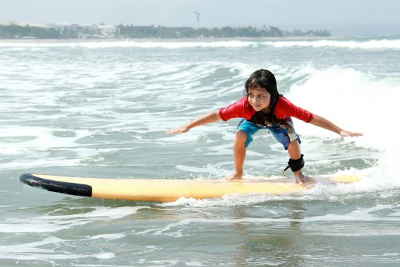 bigstock-Little-Boy-Learn-To-Surf-At-Oc-95266904