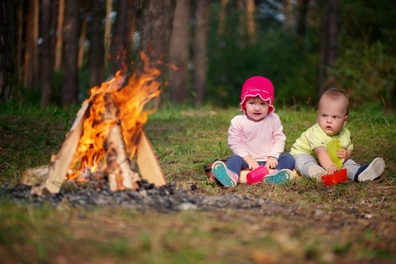 Be careful of the fire when camping with a baby