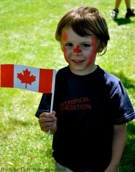 Canada with kids child holding flag