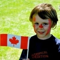 Canada-with-kids-child-holding-flag_Weekly_Digest_Trekaroo_carousel
