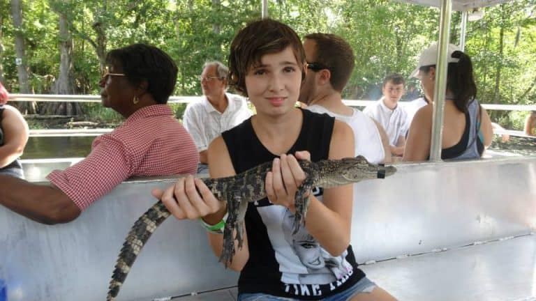 holding a gator is one of the fun things to do in Louisiana