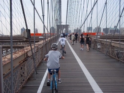 Biking the Brooklyn Bridge is a must when visiting NYC with kids