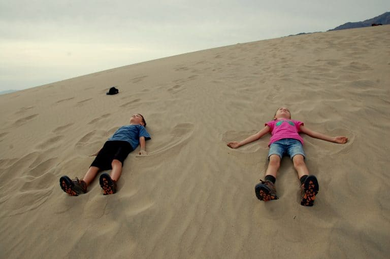 Making sand angels on the Mesquite Flat Sand Dunes in Death Valley National Park