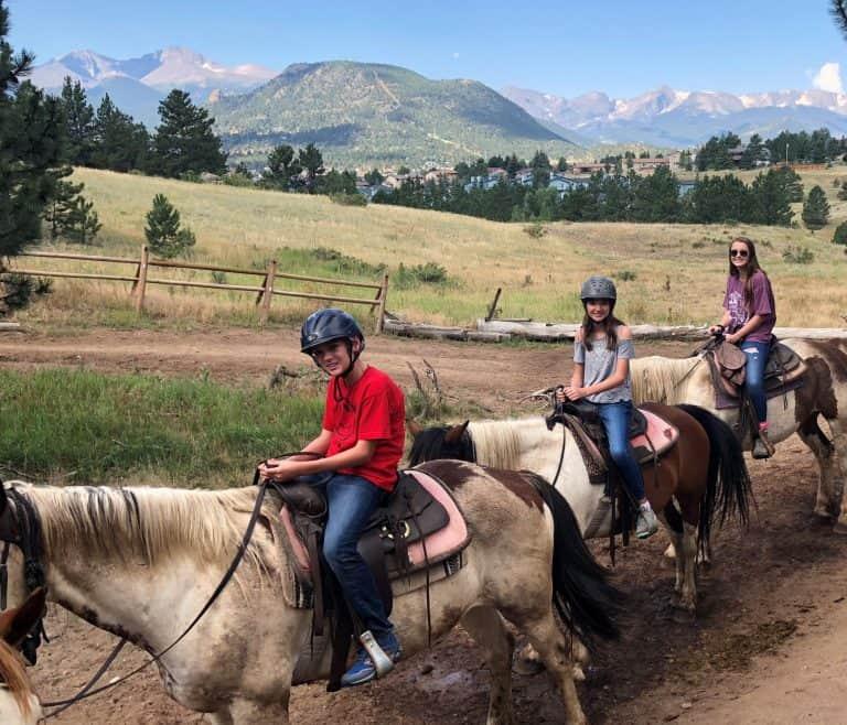 Horseback rising near Rocky Mountain National Park with kids