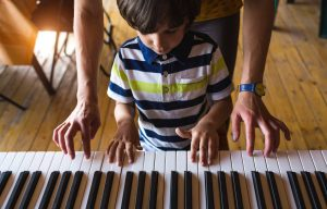 Classical music piano with kids | Photo by: bigstock / Zhukovvvlad