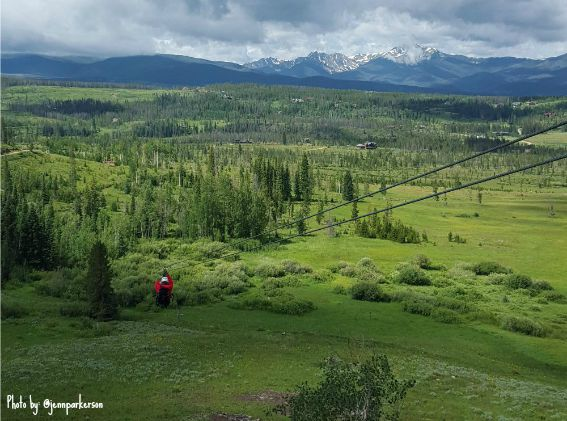 Ziplining at Devils Thumb Ranch Colorado? You bet! Adventurous families can ZOOM through breathtaking vistas together! Explore more tips on a summertime vacation in Winter Park, Colorado! #winterpark