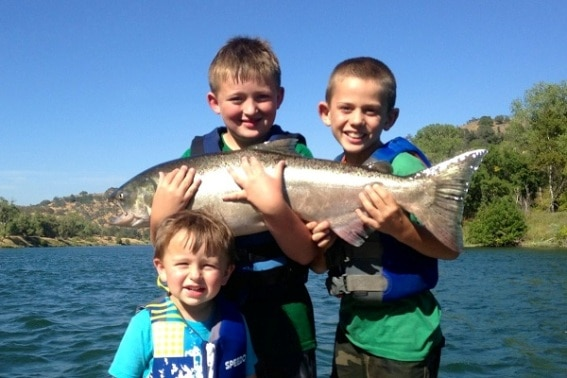 Kids fishing in Redding, California- Just about as good as it gets. Explore Outdoor Activities in Redding, CA - From hiking and biking to fishing, houseboating, exploring national and state parks, caves, and so much more, Redding is much more than a gas stop on your route through Northern California #Redding #trekarooing #familytravel