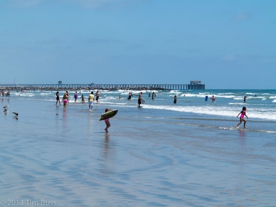 Oceanside-beach-Swimmers-Flickr-Tim-Buss