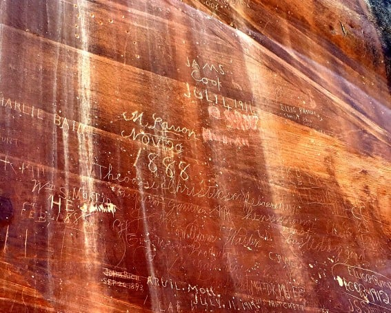 Further in to Capitol Reef National Park, you will come across a Pioneer Registry on the side of the slot canyon. Pioneers passing through the region in the late 1800s and early 1900s etched and burned their names into the sandstone wall.