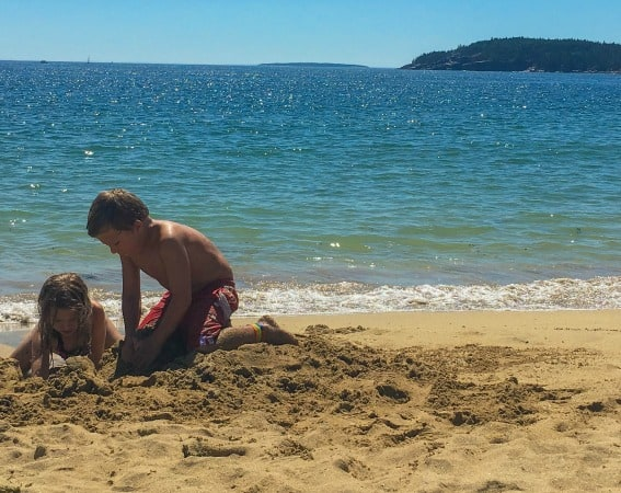 Build a sandcastle at the beach in Acadia National Park while the blue waters swirl around you.
