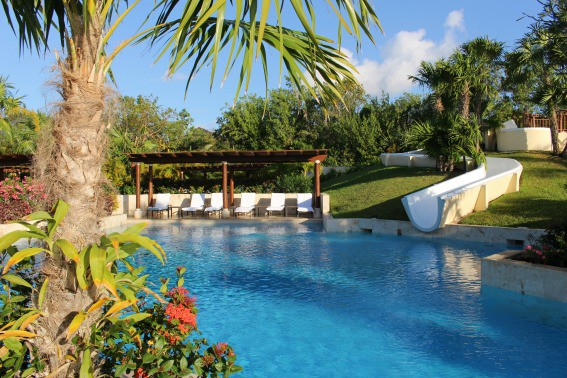 Waterslide and pool at the Fairmont Riviera Maya