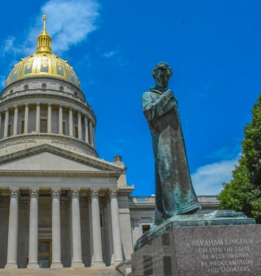 West Virginia Tourism: The state capitol and Abraham Lincoln's statue