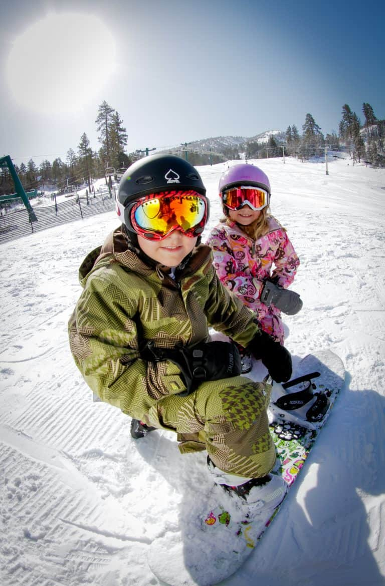 Kids snowboarding Bear Mountain Resort