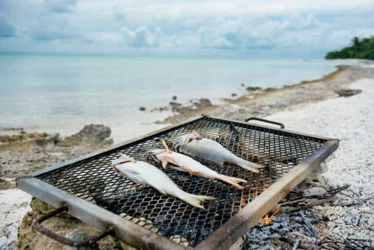 Cooking fish in Rangiroa, Tahiti