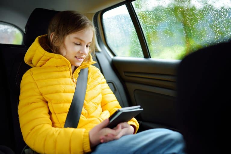 Child reading in a car