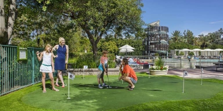 Things to do in scottsdale with kids Family at Putting Green at Hyatt Regency Scottsdale Photo Credit Visit PhoenixHyatt Regency Scottsdale Resort & Spa at Gainey Ranch
