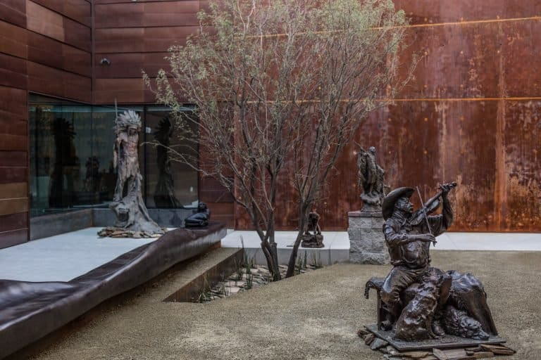 The sculpture courtyard at Western Spirit Scottsdale's Museum of the West features eco-friendly weeping wall. Credit Chad Ulam
