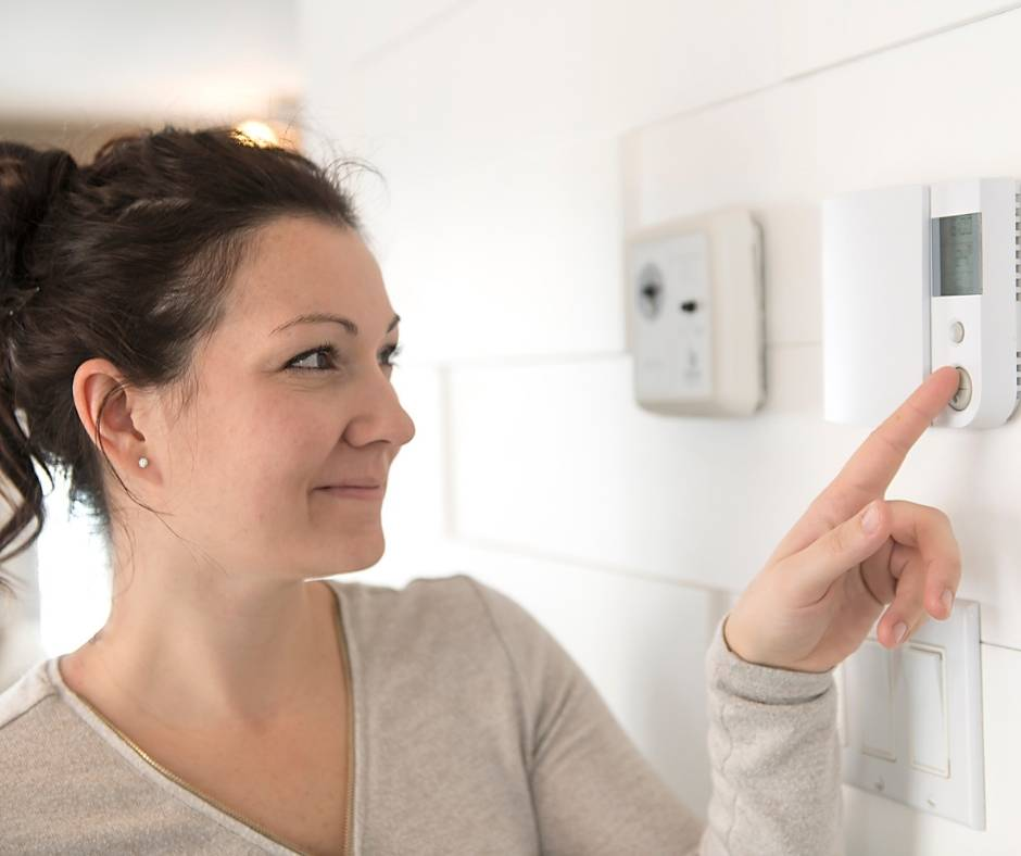 Your house checklist before vacation should include adjusting the thermostat